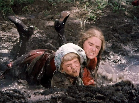 Laura and Nellie fight in the mud.